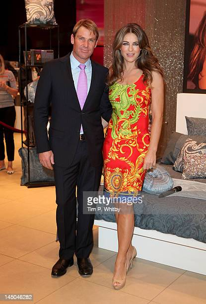 Elizabeth Hurley makes a personal appearance joined by her fiancee Shane Warne to launch her new bed linen collection at House of Fraser on May 23...