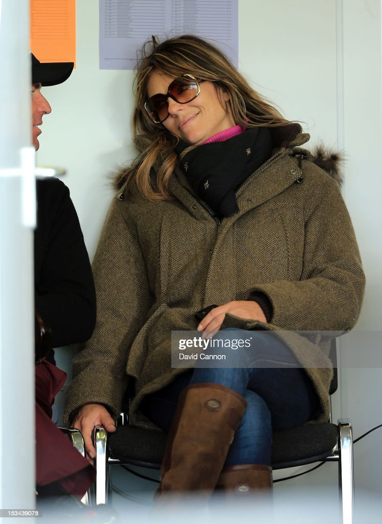 <a gi-track='captionPersonalityLinkClicked' href=/galleries/search?phrase=Elizabeth+Hurley&family=editorial&specificpeople=201731 ng-click='$event.stopPropagation()'>Elizabeth Hurley</a> of England the actress with her fiancee the Australian Cricketer <a gi-track='captionPersonalityLinkClicked' href=/galleries/search?phrase=Shane+Warne&family=editorial&specificpeople=167242 ng-click='$event.stopPropagation()'>Shane Warne</a> after Warne had finished his round the second round of the Alfred Dunhill Links Championship on the Championship Links at Carnoustie on October 5, 2012 in Carnoustie, Scotland.