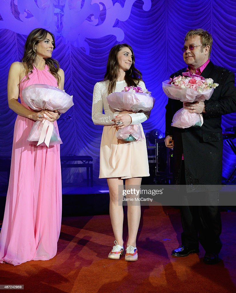 Elizabeth Hurley, Sara Bareilles and Elton John pose onstage at The Breast Cancer Foundation's 2014 Hot Pink Party at Waldorf Astoria Hotel on April 28, 2014 in New York City.