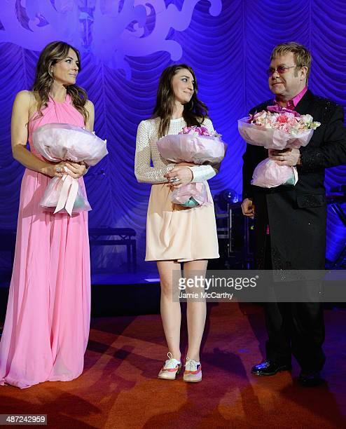 Elizabeth Hurley Sara Bareilles and Elton John pose onstage at The Breast Cancer Foundation's 2014 Hot Pink Party at Waldorf Astoria Hotel on April...