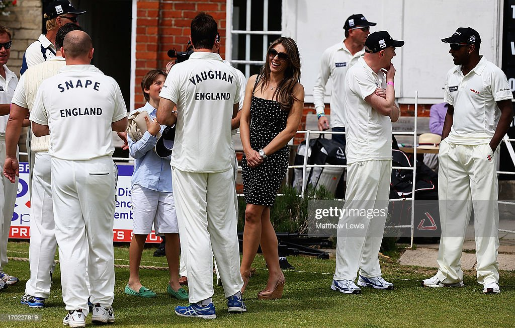 Elizabeth Hurley talks to Michael Vaughan during the Shane Warne's Australia vs Michael Vaughan's England T20 match at Circenster Cricket Club on June 9, 2013 in Cirencester, England.