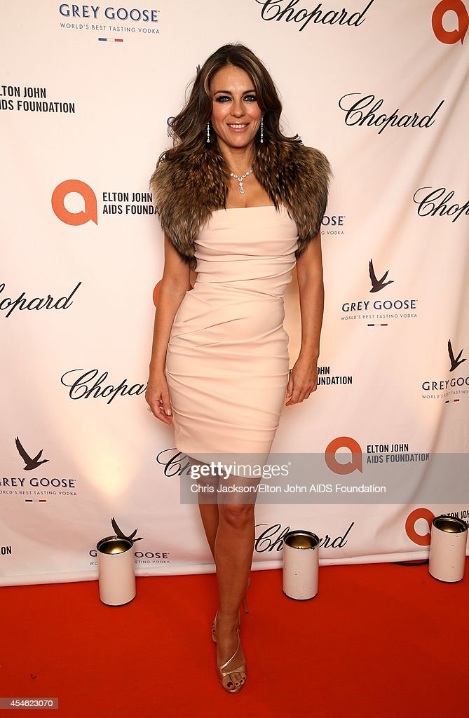 Elizabeth Hurley wearing Chopard attends the Woodside End of Summer party to benefit the Elton John AIDS Foundation sponsored by Chopard and Grey...