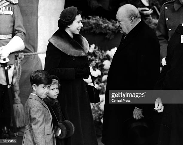 Elizabeth II Queen of England with Prince Charles and Princess Anne chatting to Sir Winston Churchill