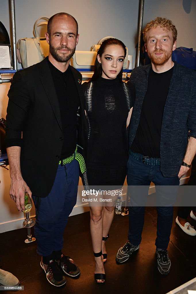 Elizabeth Jane Bishop (C) poses with Bottletop founders Cameron Saul (L) and Oliver Wayman at the Bottletop Regent Street store launch on May 24, 2016 in London, England.