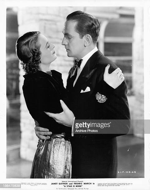 Elizabeth Jenns dances with Fredric March in a scene from the film 'A Star Is Born' 1937