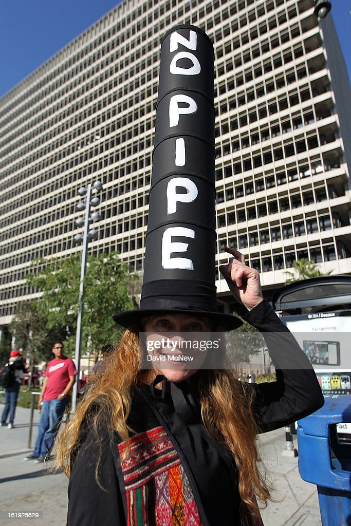 Elizabeth Lerer wears a pipe-shaped hat to express her opposition to the controversial Keystone XL Pipeline during the 'Forward on Climate' rally to call on President Obama to take strong action on the climate crisis on February 17, 2013 in Los Angeles, California. Organizers say the rally, which is led by Tar Sands Action Southern California and Sierra Club, is composed of a coalition of over 90 groups and coincides with similar rallies in Washington D.C. and other U.S. cities.