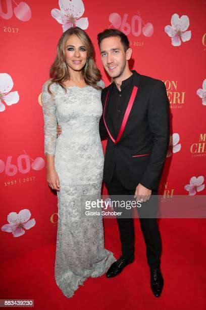 Elizabeth 'Liz' Hurley and Marcel Remus during the Mon Cheri Barbara Tag at Postpalast on November 30 2017 in Munich Germany