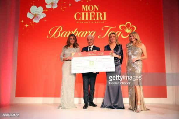 Elizabeth 'Liz' Hurley Carlo Vassallo Director Ferrero Germany Maria Furtwaengler and Frauke Ludowig with cheques during the Mon Cheri Barbara Tag at...