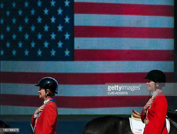 US Elizabeth Madden Silver Medal and Cristine McCrea Gold Medal attend the Podium Ceremony during the equestrian Individual Jumping final at the...