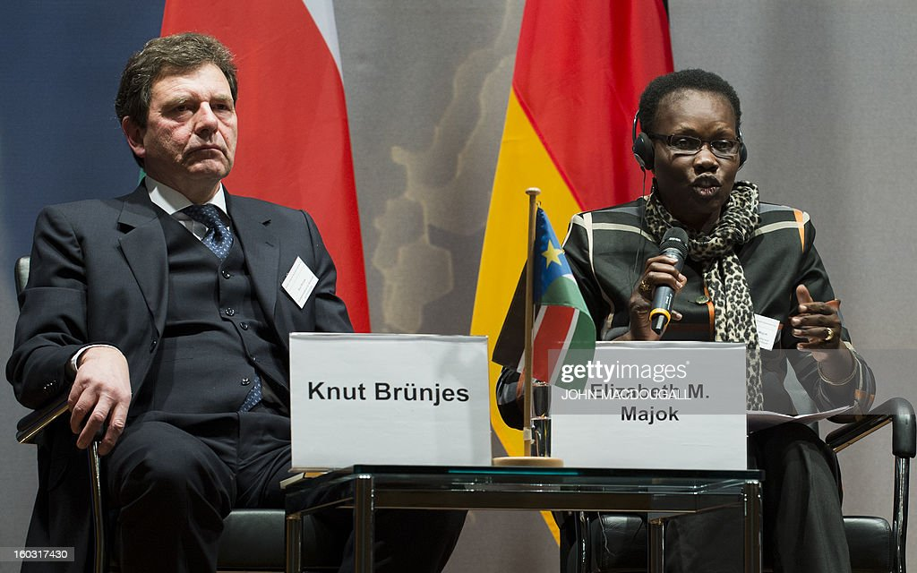 Elizabeth Majok, (R) the undersecretary of the Ministry of Commerce in South Sudan, addresses the opening session of the Germany, Sudan and South Sudan Business Day, as Knut Bruenjes from the German Ministry of Economy looks on at the foreign ministry in Berlin January 29, 2013. The one day event, sponsored by the German foreign ministry, the German-African Business Association and the Arab-German Chamber of Commerce and Industry, is expected to promote trade between the three countries.