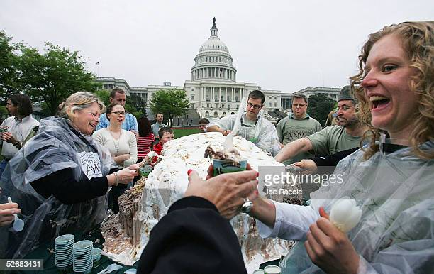 Elizabeth McDonough who works for Ben and Jerry's ice cream company hands out part of a 1140 pound Baked Alaska which was made from Fossil Fuel ice...