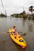 Elizabeth McFarren paddles her kayak through flood waters pushed up from Lake Pontchatrain by Hurricane Ike near the Marina on Setember 12 2008 in...