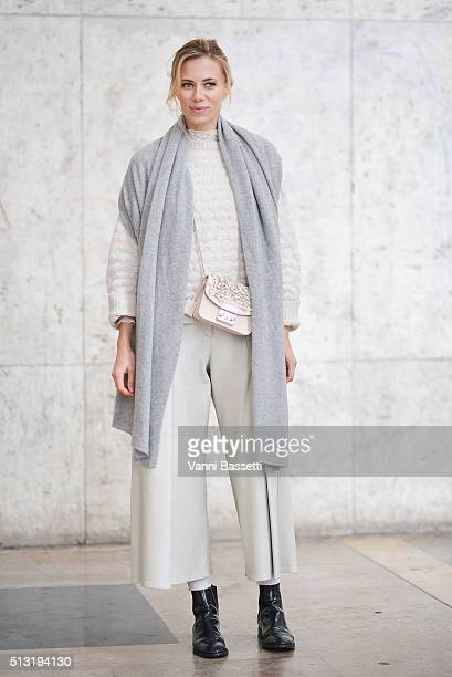 Elizabeth Minett poses wearing a Zadig and Voltaire jumper Each X Other pants Furla bag and St Laurent shoes before the Anrealage show at the Palais...