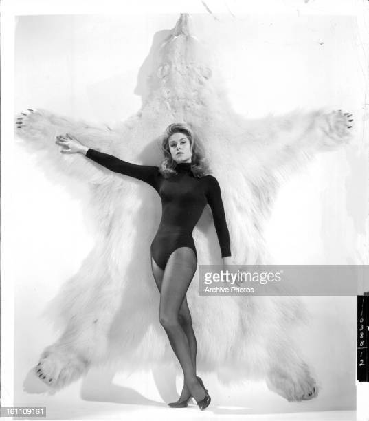 Elizabeth Montgomery stands in front of a fur in publicity portrait for the film 'Who's Been Sleeping In My Bed' 1963