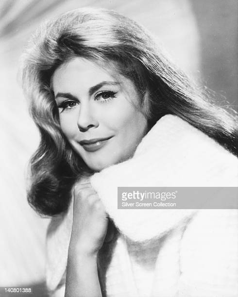 Elizabeth Montgomery US actress wearing a white fur coat in a studio portrait against a light background circa 1960