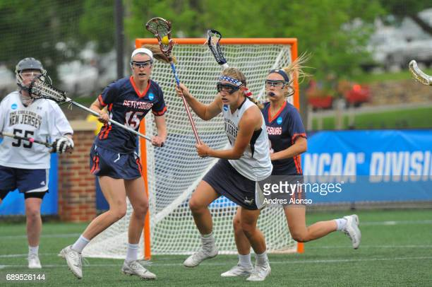 Elizabeth Morrison of College of New Jersey gets a loose shot in front of her goal during the Division III Women's Lacrosse Championship held at Kerr...