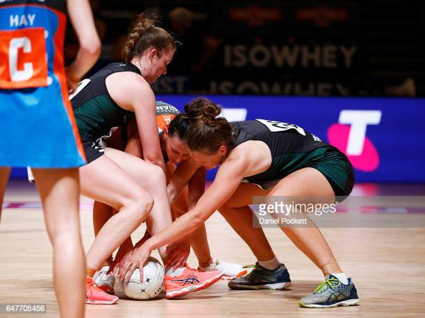 Elizabeth Nicol of the Magpies and Kara Styles of the Giants and Samantha Gooden of the Magpies compete for the ball during the round three...