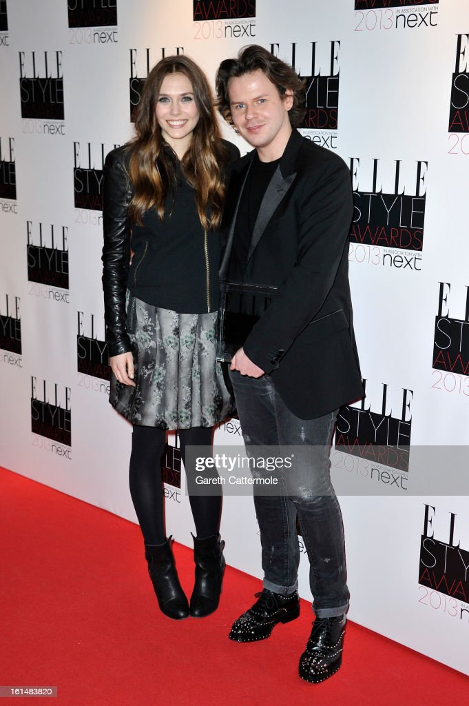 Elizabeth Olsen and Best Britsh Designer of the Year winner Christopher Kane poses in the press room during the Elle Style Awards at The Savoy Hotel on February 11, 2013 in London, England.