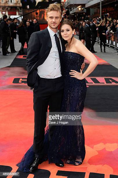 Elizabeth Olsen and Boyd Holbrook attend the European premiere of 'Godzilla' at the Odeon Leicester Square on May 11 2014 in London England