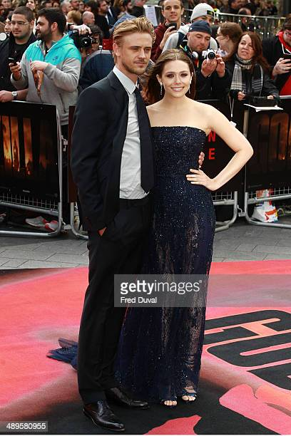 Elizabeth Olsen and Boyd Holbrook attend the European premiere of 'Godzilla' at Odeon Leicester Square on May 11 2014 in London England