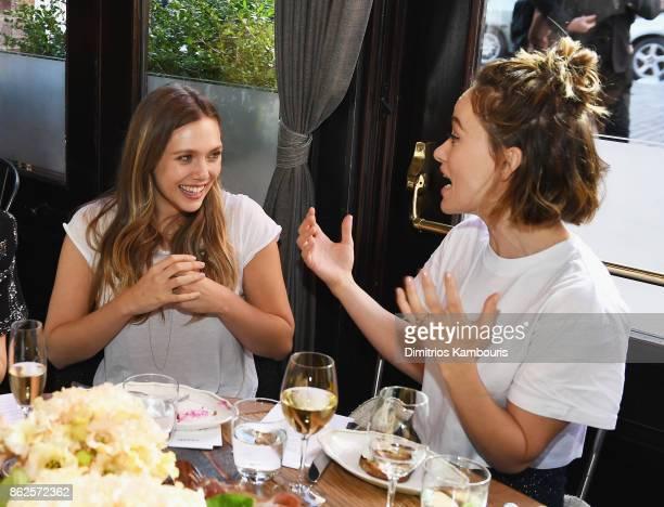 Elizabeth Olsen and Olivia Wilde attend Through Her Lens The Tribeca Chanel Women's Filmmaker Program Luncheon at Locanda Verde on October 17 2017 in...