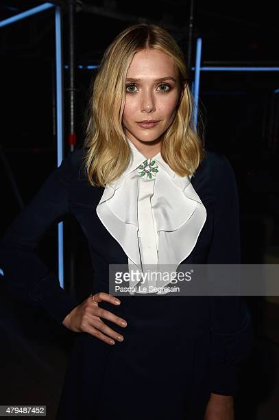 Elizabeth Olsen attends a cocktail during Miu Miu Club Launch Of the First Miu Miu Fragrance And Croisiere 2016 Collection at Palais d'Iena on July 4...