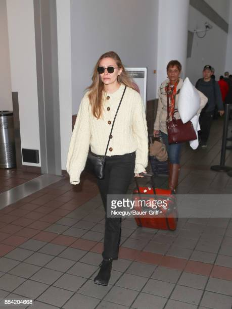 Elizabeth Olsen is seen at Los Angeles International Airport on December 01 2017 in Los Angeles California