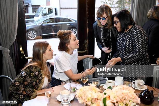 Elizabeth Olsen Olivia Wilde Jane Rosenthal and Mira Nair attend Through Her Lens The Tribeca Chanel Women's Filmmaker Program Luncheon at Locanda...