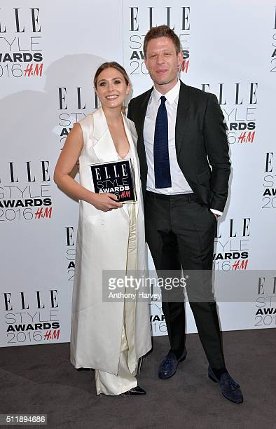 Elizabeth Olsen poses with her award for Actress of The Year with James Norton in the winners room at The Elle Style Awards 2016 on February 23 2016...