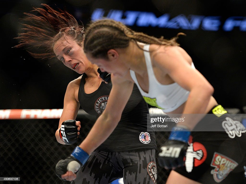 Elizabeth Phillips punches Valerie Latourneau during the UFC 174 event at Rogers Arena on June 14, 2014 in Vancouver, British Columbia, Canada.