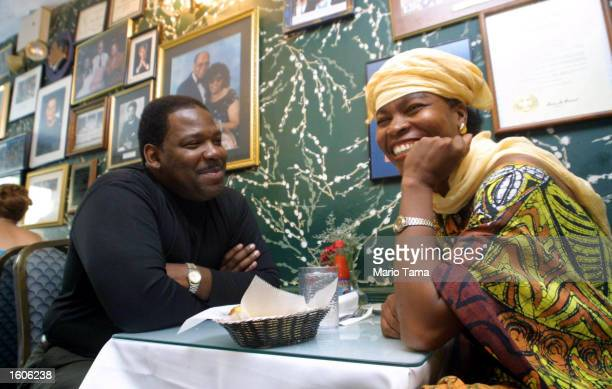Elizabeth Pichardo right and Stephen Gray dine at Sylvia''s soul food restaurant where former President Bill Clinton has eaten lunch August 1 2001 in...