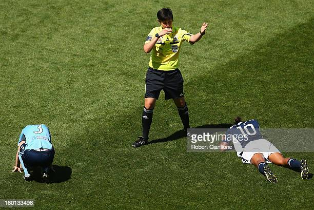 Elizabeth Ralston of Sydney FC and Jessica McDonald of the Victory after clashing heads during the WLeague Grand Final between the Melbourne Victory...