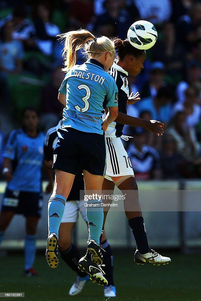 Elizabeth Ralston of Sydney FC (L) and Jessica McDonald of the Victory compete in the air during the W-League Grand Final between the Melbourne Victory and Sydney FC at AAMI Park on January 27, 2013 in Melbourne, Australia.