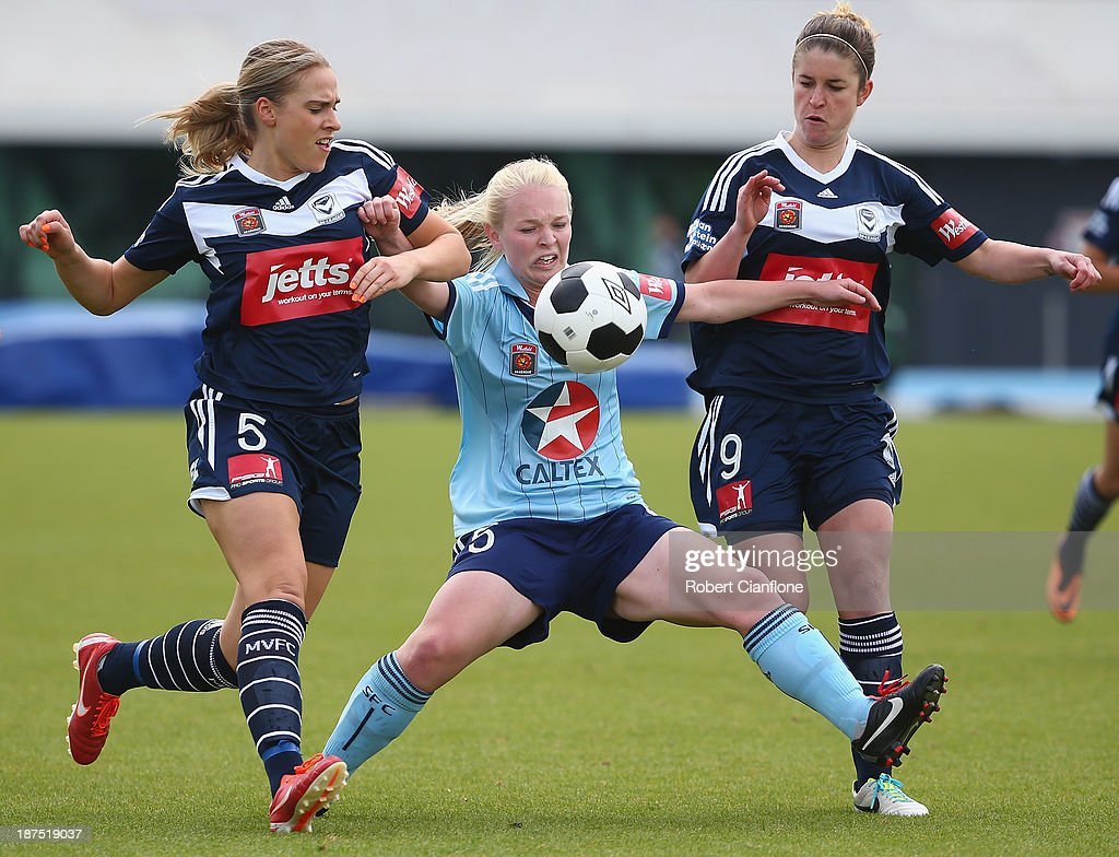 Elizabeth Ralston Sydney FC is challenged by Laura Spiranovic and Caitlin Friend of the Victory during the round one W-League match between the Melbourne Victory and Sydney FC at Lakeside Stadium on November 10, 2013 in Melbourne, Australia.