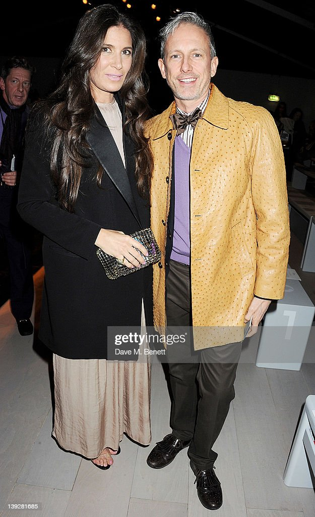 Elizabeth Saltzman Walker (L) and Patrick Cox attend in the front row at the Issa London catwalk show during London Fashion Week Autumn/Winter 2012 at Somerset House on February 18, 2012 in London, England.