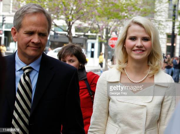 Elizabeth Smart and her father Ed Smart walk away from federal court after the sentencing of Elizabeths kidnapper Brian David Mitchell May 25 2011 in...