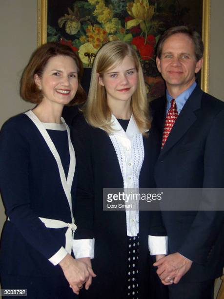 Elizabeth Smart poses for a portrait with her parents Ed and Lois at their home February 22 2004 in Salt Lake City UT
