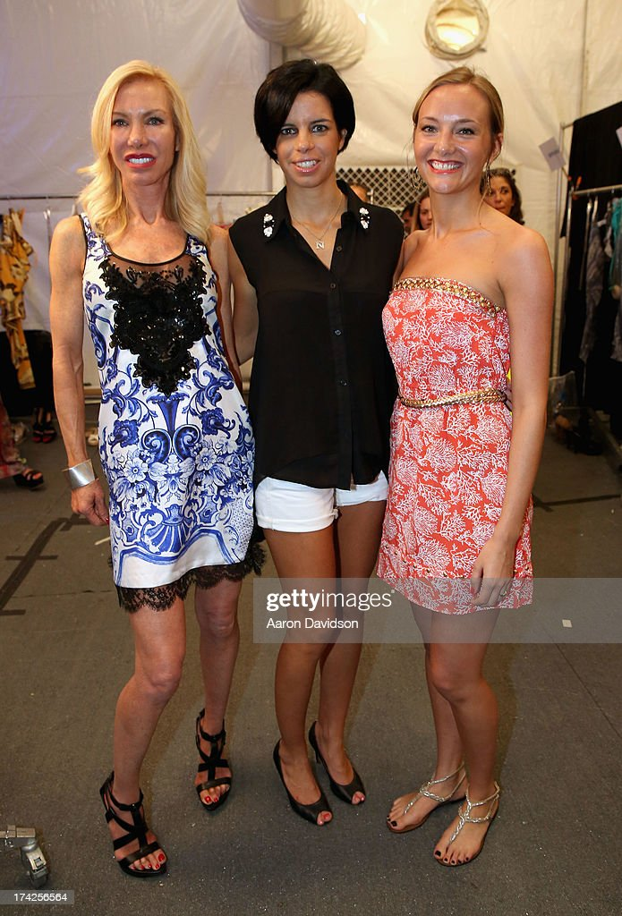 Elizabeth Southwood (L) and <a gi-track='captionPersonalityLinkClicked' href=/galleries/search?phrase=Naila+Chbib&family=editorial&specificpeople=7106033 ng-click='$event.stopPropagation()'>Naila Chbib</a> (C) pose backstage at the Naila/ Sauvage/ Zingara Swimwear show At Mercedes-Benz Fashion Week Swim 2014 at Cabana Grande at the Raleigh on July 22, 2013 in Miami, Florida.