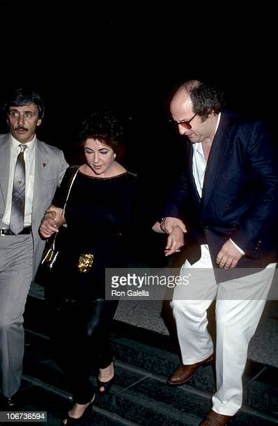 Elizabeth Taylor and Guests during Elizabeth Taylor and Guests leaving after a performance of 'Present Laughter' New York July 23 1982 at Circle in...