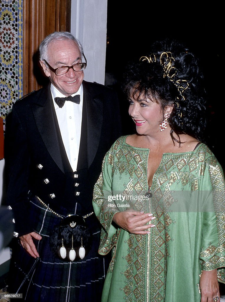 <a gi-track='captionPersonalityLinkClicked' href=/galleries/search?phrase=Elizabeth+Taylor&family=editorial&specificpeople=69995 ng-click='$event.stopPropagation()'>Elizabeth Taylor</a> and <a gi-track='captionPersonalityLinkClicked' href=/galleries/search?phrase=Malcolm+Forbes&family=editorial&specificpeople=218186 ng-click='$event.stopPropagation()'>Malcolm Forbes</a>