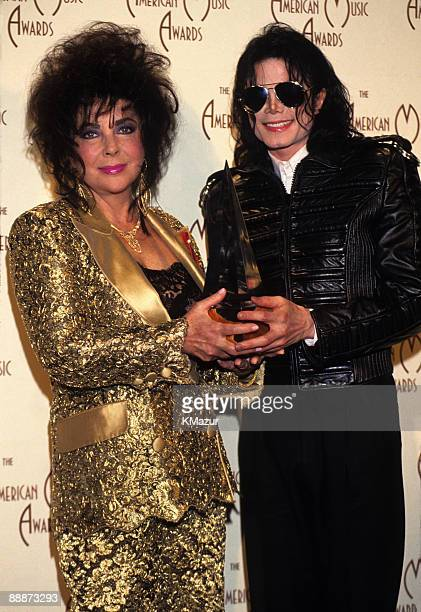 Elizabeth Taylor and Michael Jackson attend the 20th Annual American Music Awards at the Shrine Auditorium on January 25 1993 in Los Angeles...