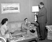 Elizabeth Taylor and Nicky Hilton who used to be Mister and Missus study each other at close but not to close range in Liz' Hotel Plaza suite and...