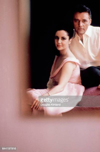 Elizabeth Taylor and Richard Burton are reflected in a mirror