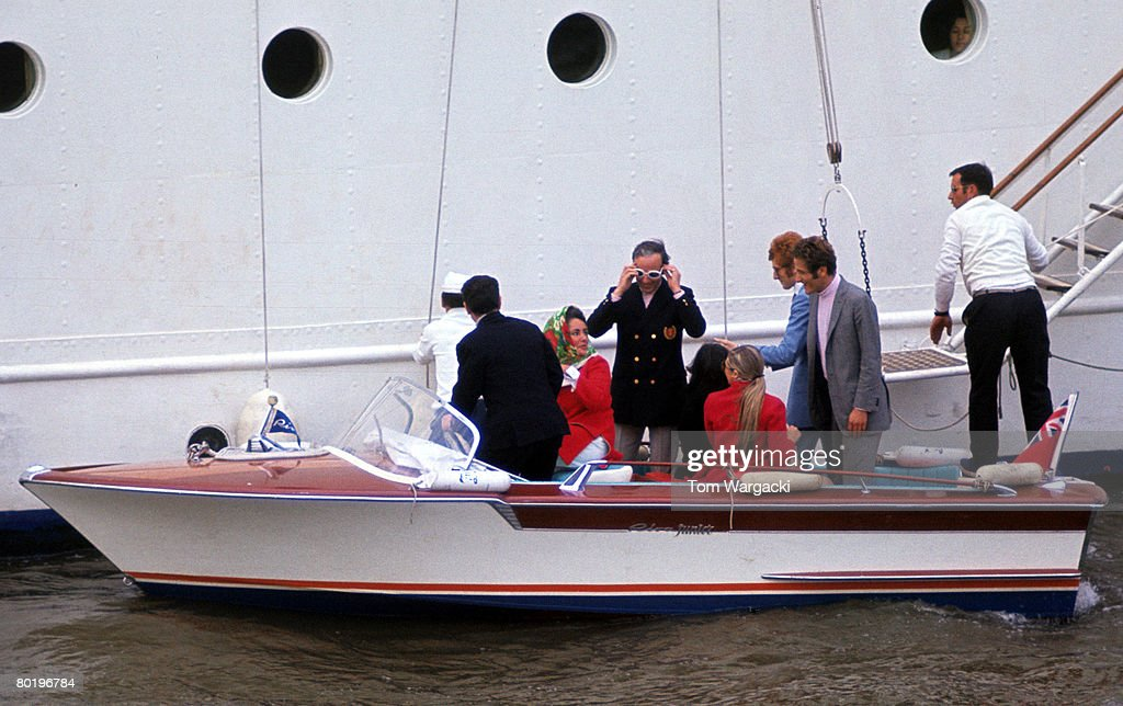 Elizabeth Taylor and Richard Burton on their yacht Kalizma, moored on the river Thames at Rotherhithe