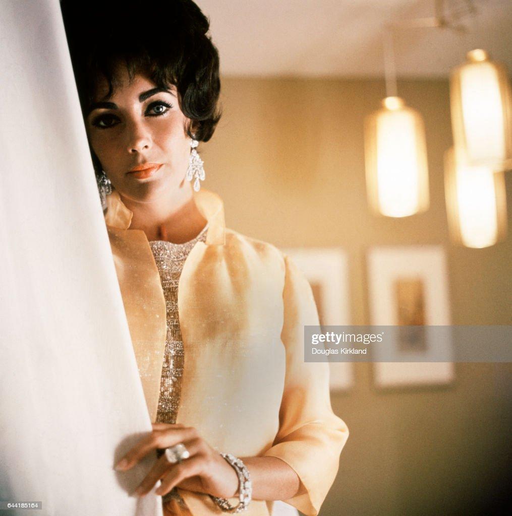 Elizabeth Taylor Behind Curtain