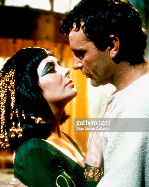 Elizabeth Taylor British actress and Richard Burton British actor both in costume in a passionate embrace in a publicity still issued for the film...
