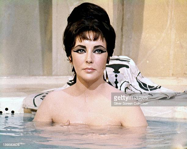 Elizabeth Taylor British actress bathing with the water at chest height in a publicity still issued for the film 'Cleopatra' 1963 The historical...