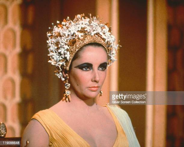 Elizabeth Taylor British actress in costume with gold jewellery in a publicity still issued for the film 'Cleopatra' 1963 The historical drama...
