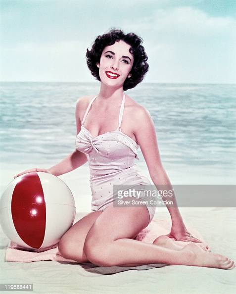 Vintage Pinup Girl Wearing Bathing Suit At The Ocean Stock: Swimwear Stock Photos And Pictures