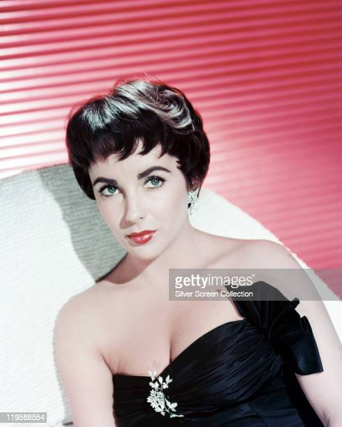 Elizabeth Taylor British actress with cropped hair wearing a black strapless dress circa 1955
